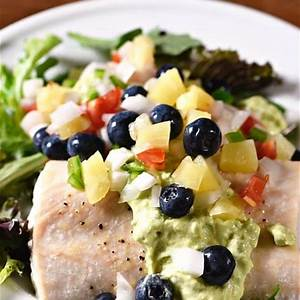 baked-mahi-mahi-with-pineapple-blueberry-salsa image