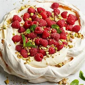lemon-cream-pavlova-with-berries-better-homes-gardens image