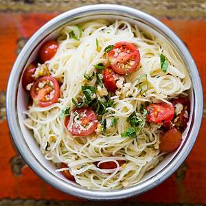angel-hair-pasta-with-clams-cherry-tomatoes-and-basil image