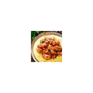 saucy-chicken-and-sausage-over-creamy-parmesan-polenta image