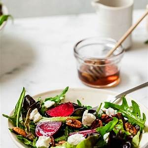 baby-greens-with-goat-cheese-beets-and-candied-pecans image
