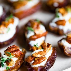 goat-cheese-stuffed-dates-with-roasted-pecans-eating image