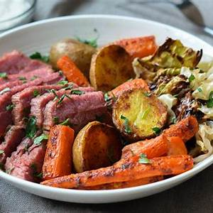roasted-corned-beef-and-cabbage-with-carrots-potatoes image