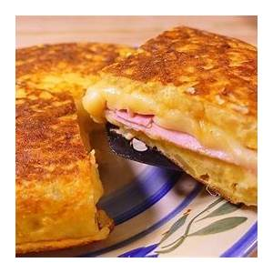 potato-omelette-stuffed-with-ham-and-cheese image