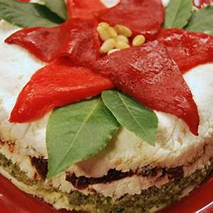 layered-pesto-and-sundried-tomato-dip-the-cooking image
