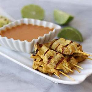 chicken-satay-with-peanut-dipping-sauce-and-fresh-cucumber image