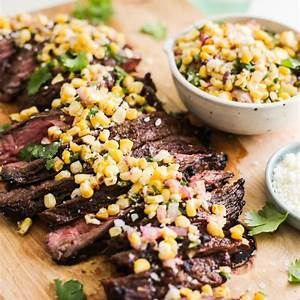 grilled-steak-with-corn-salsa-and-veggies-the-defined-dish image