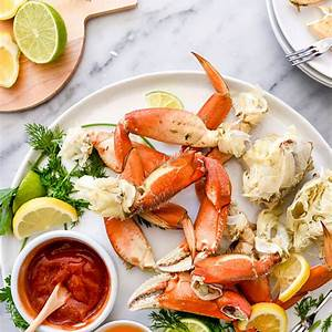 the-easiest-whole-dungeness-crab-recipe-foodiecrushcom image