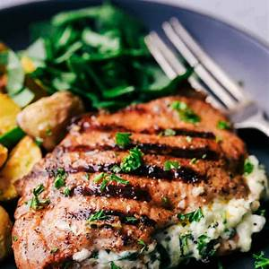 grilled-spinach-and-herb-stuffed-pork-chops image