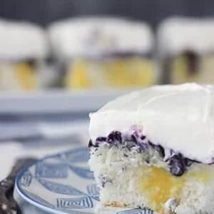 blueberry-cheesecake-poke-cake-easy-cake-recipe-beyond image