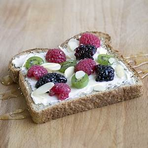 toast-with-cream-cheese-fruits-and-honey-metro image