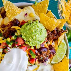 ultimate-chili-nachos-with-queso-and-guacamole-the image