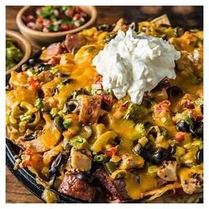 ultimate-loaded-nachos-recipe-traeger-grills image