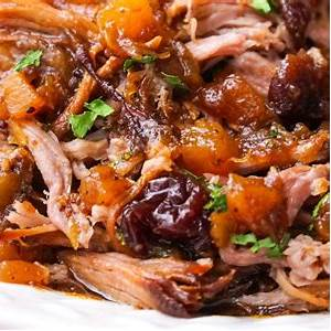 slow-cooker-pork-with-cranberry-pineapple-sauce-video image