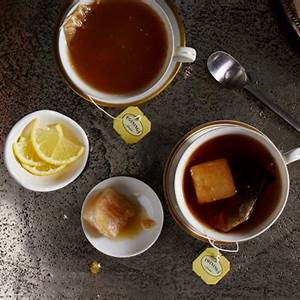 tea-with-ginger-citrus-ice-cubes-recipe-cooking-light image