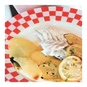 baked-whole-fish-with-potatoes-and-lemon-recipe-bon-apptit image
