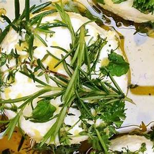 marinated-goat-cheese-with-fresh-herbs-just-a-taste image