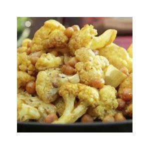 roasted-cauliflower-and-chickpeas-recipes-food-network image