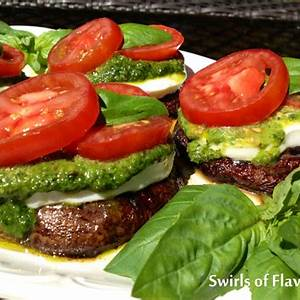 grilled-portobello-mushrooms-caprese-swirls-of-flavor image