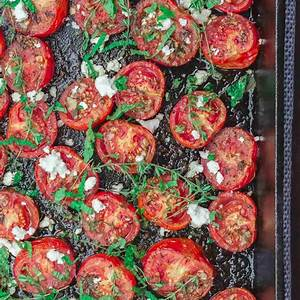 quick-oven-roasted-tomatoes-recipe-the-mediterranean-dish image