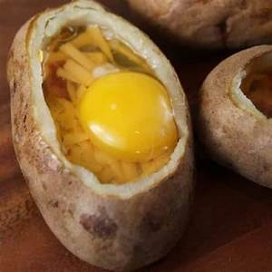 oven-baked-egg-stuffed-potatoes-magic-skillet image