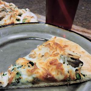 spinach-alfredo-pizza-with-shredded-chicken-24bite image