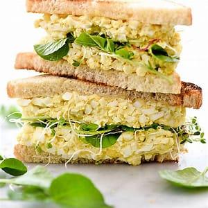 curried-egg-salad-sandwich-recipe-foodiecrushcom image