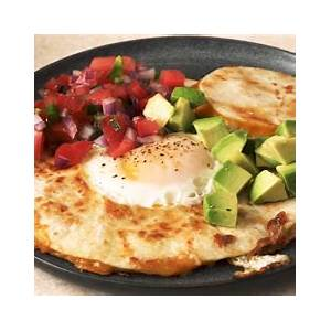 best-egg-in-a-hole-quesadillas-recipe-how-to-delish image