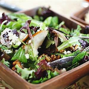 spring-greens-with-pears-sugared-walnuts-gorgonzola image