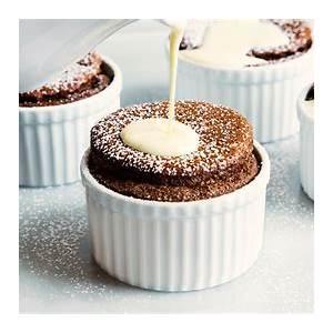 chocolate-souffl-with-orange-sauce-recipe-tasting-table image