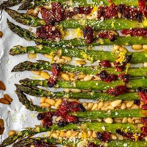 oven-roasted-asparagus-recipe-with-sun-dried-tomatoes image