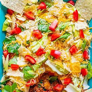 easy-layered-taco-salad-with-ground-beef-averie-cooks image