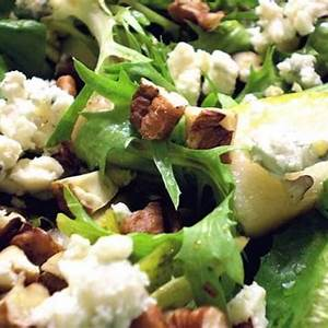 healthy-delicious-mixed-greens-with-pears-pecans-blue image
