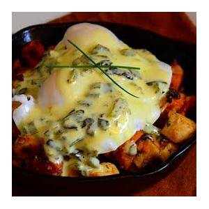 sweet-potato-chicken-hash-with-a-poached-egg image
